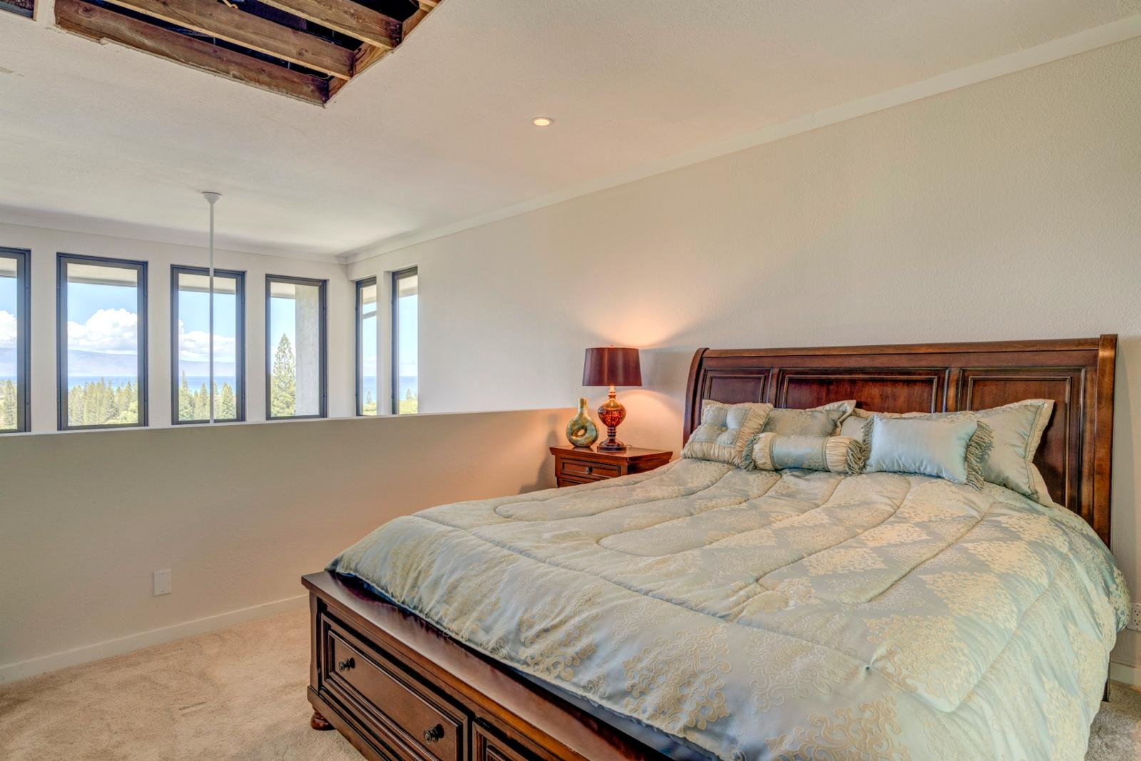 Large master suite with tons of natural lighting and sweeping Kapalua views