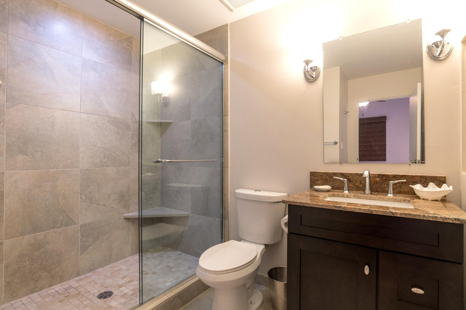 Guest bathroom located on floor 1 with Jack n Jill entry from hallway and guest bedroom 1