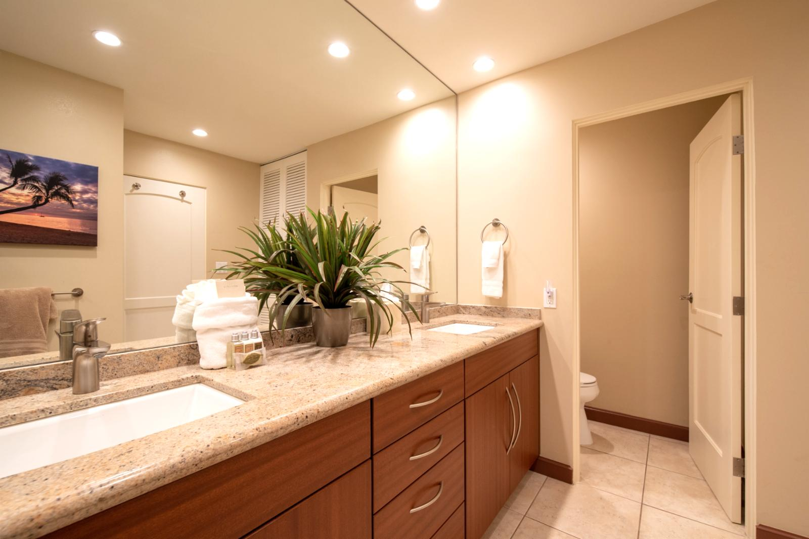 Custom countertops and private access to the guest bath