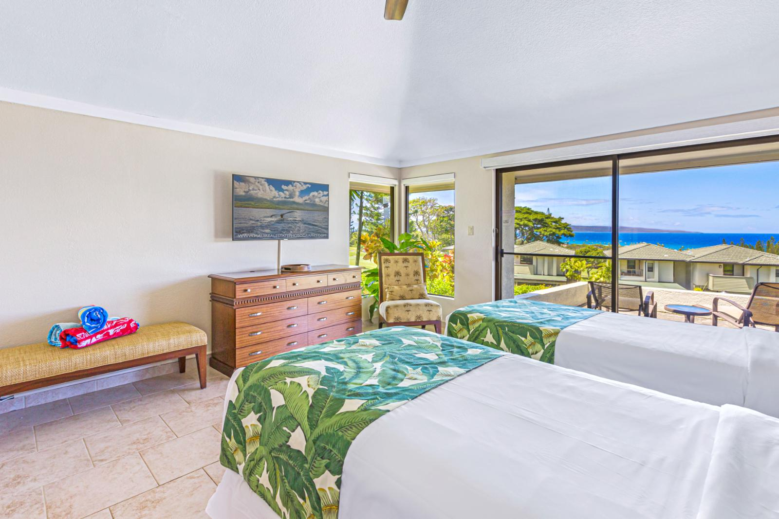 Stunning views of the ocean right from this amazing guest bedroom!