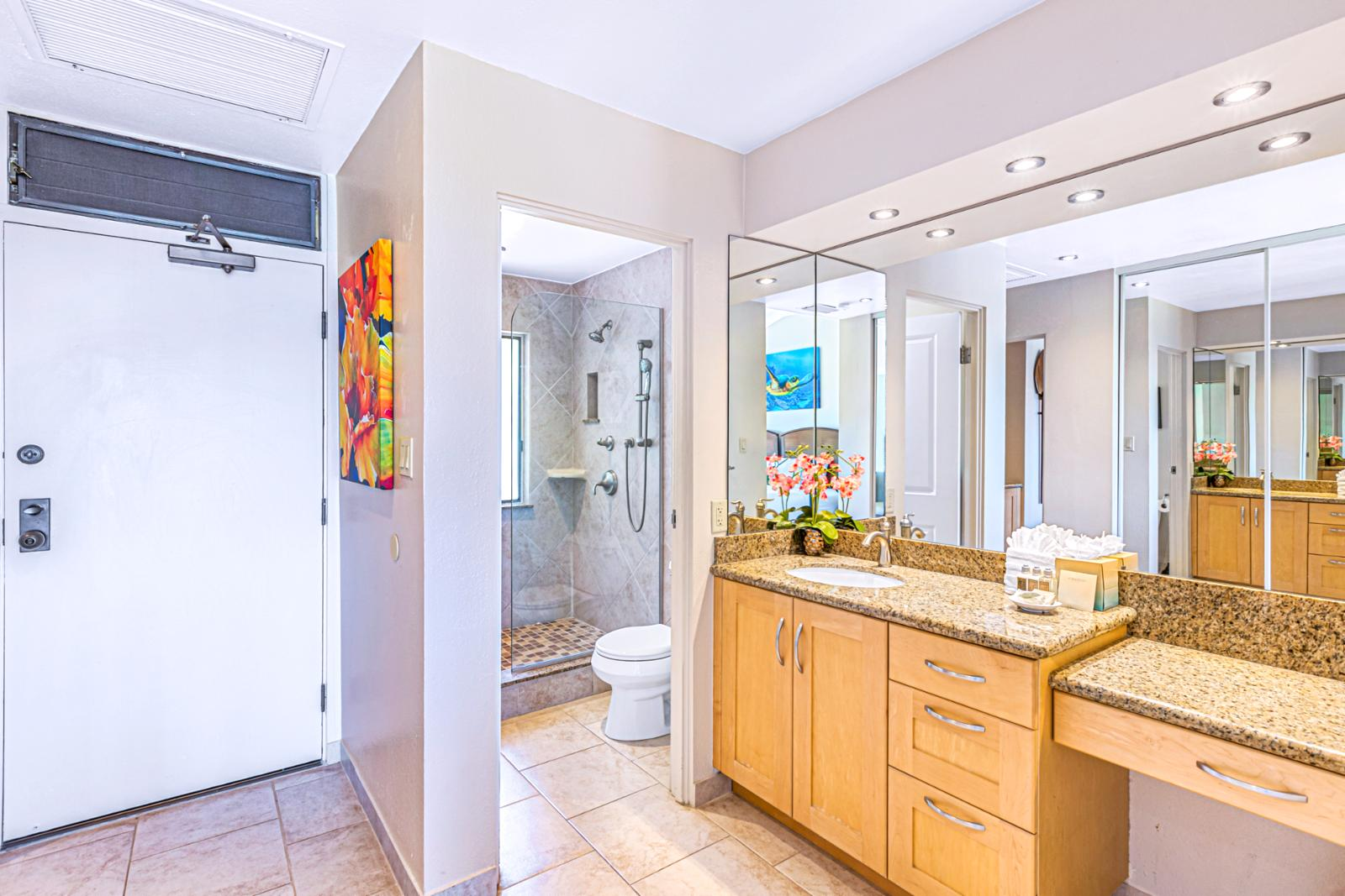 Custom countertops and cabinetry throughout this bathroom.