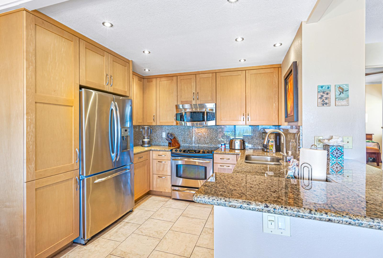 Stainless steel appliances throughout.