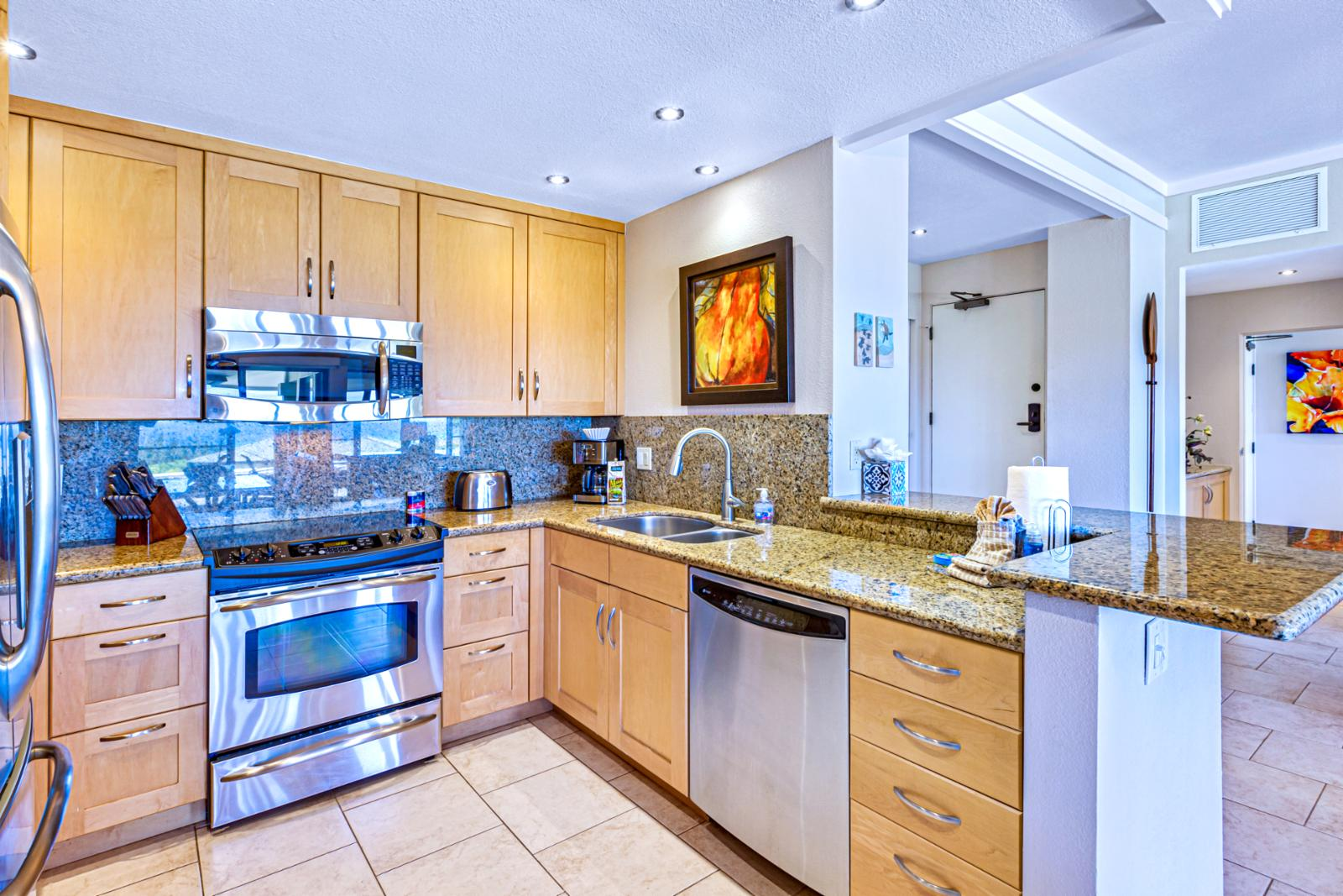 Custom cabinetry and full-size appliances throughout this gourmet kitchen.