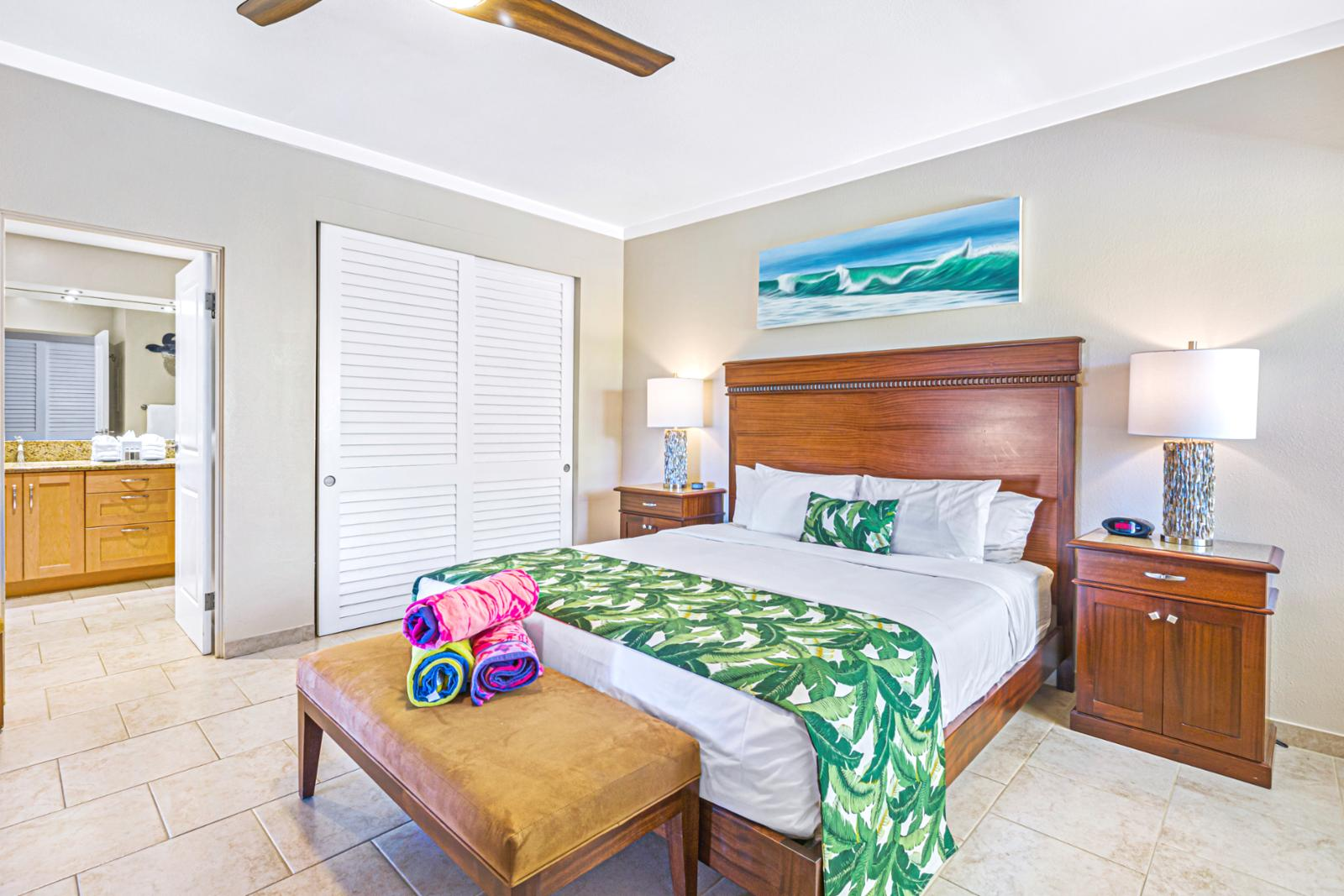 Large master suite that is tastefully furnished.