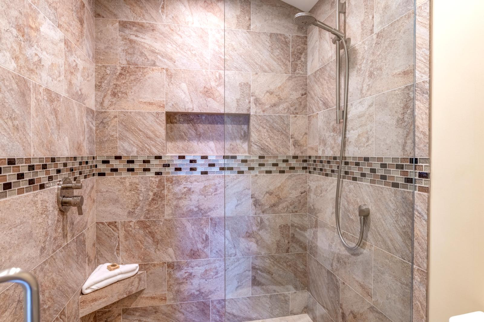 Newly Re-Modeled Walk in Showers w/ adjustable handle shower head.