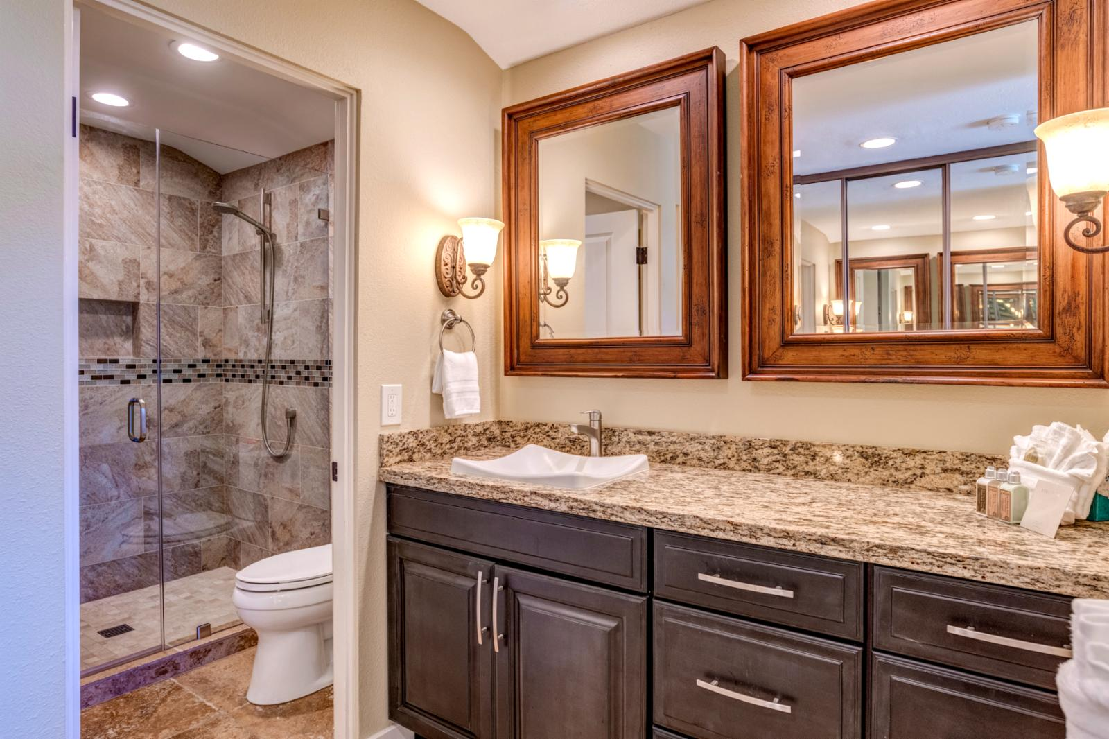 Dual sinks and walk in shower.