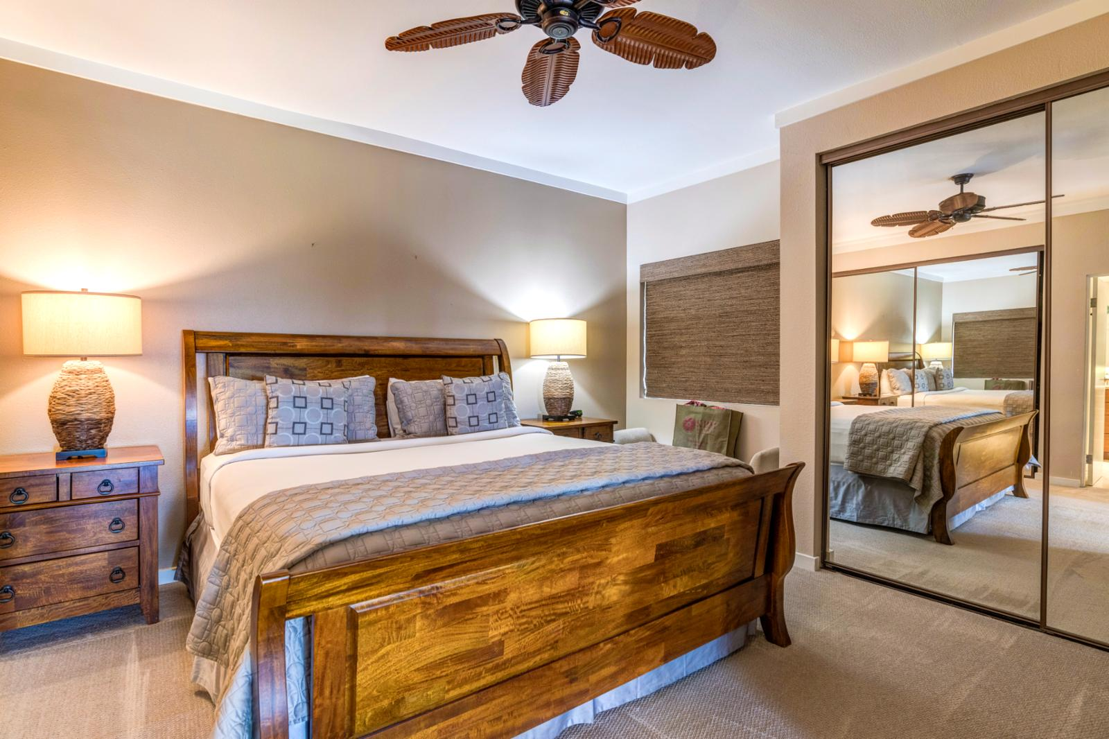 Comfortable King bed equipped with ceiling fan and private entry with stunning decor