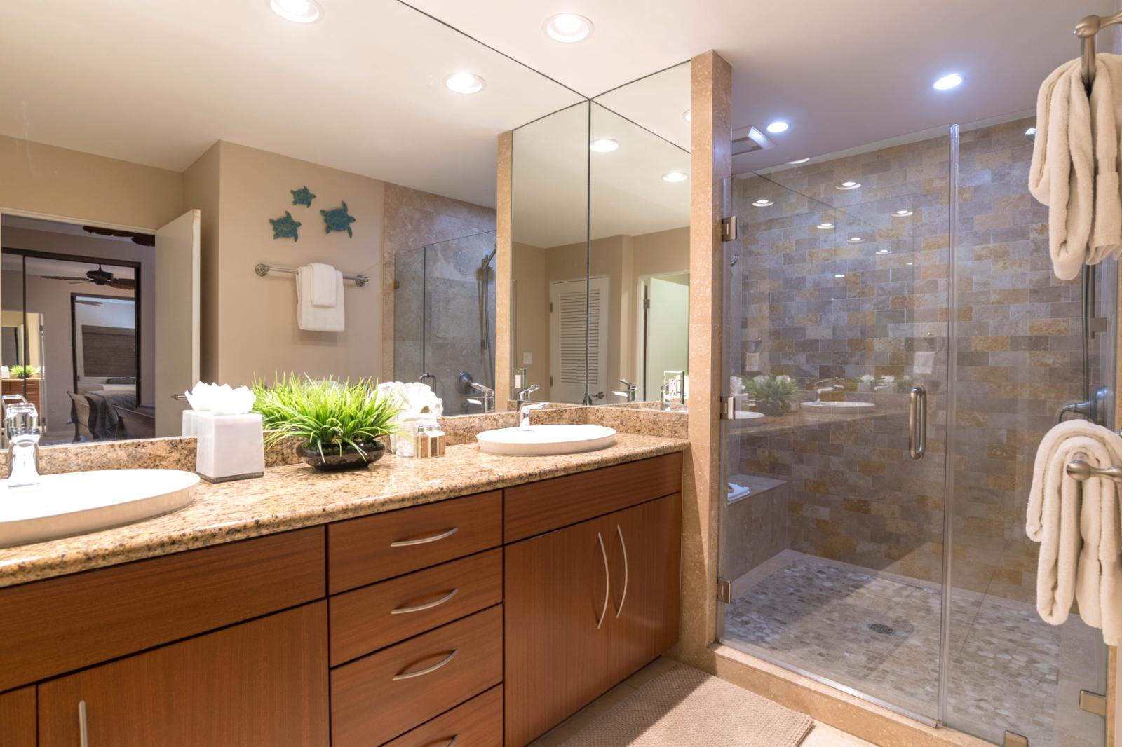 Remastered dual sinks with upgraded walk in shower, glass enclosed floor to ceiling
