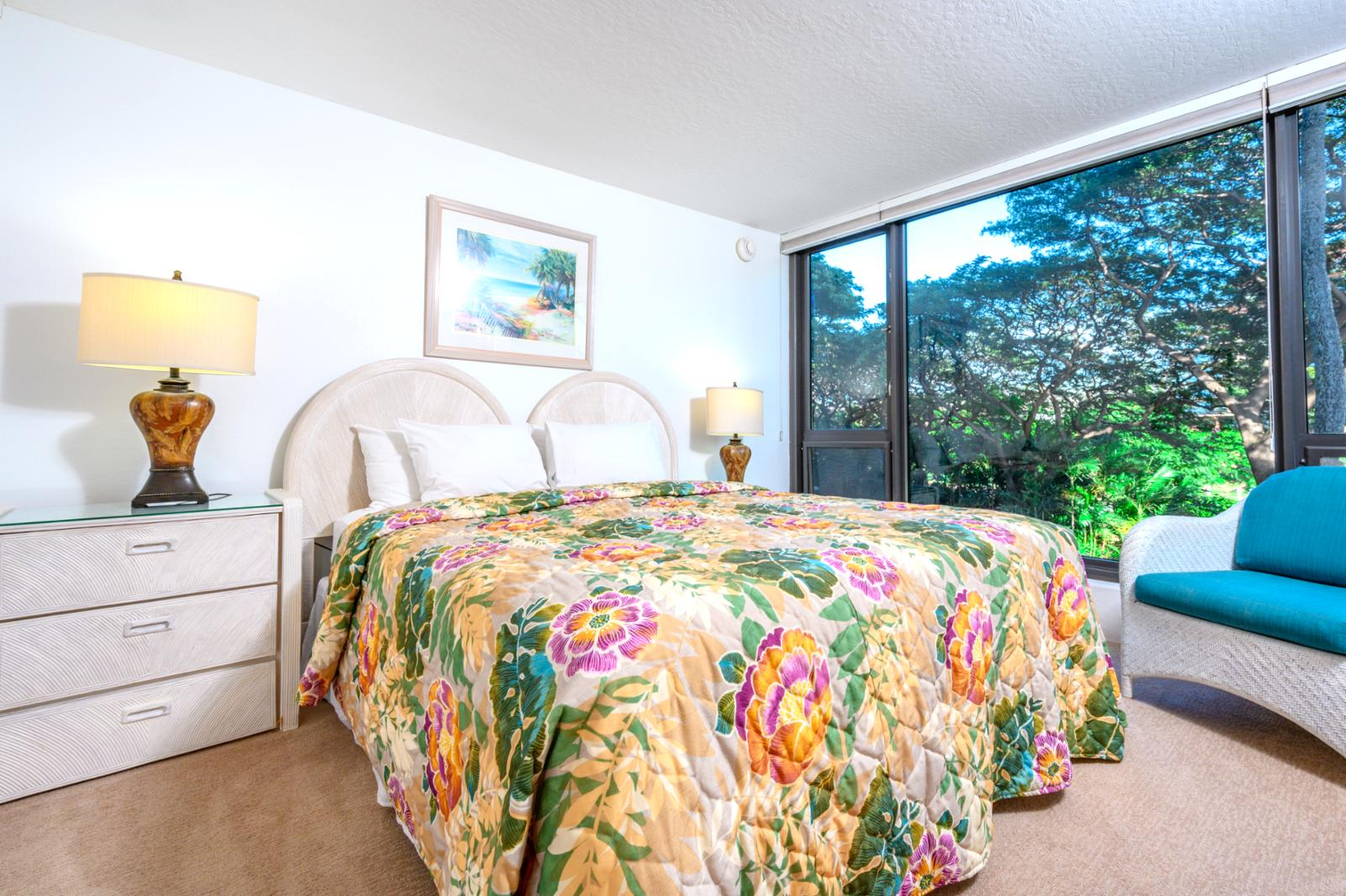 Large comfortable King bed with resort views and natural lighting