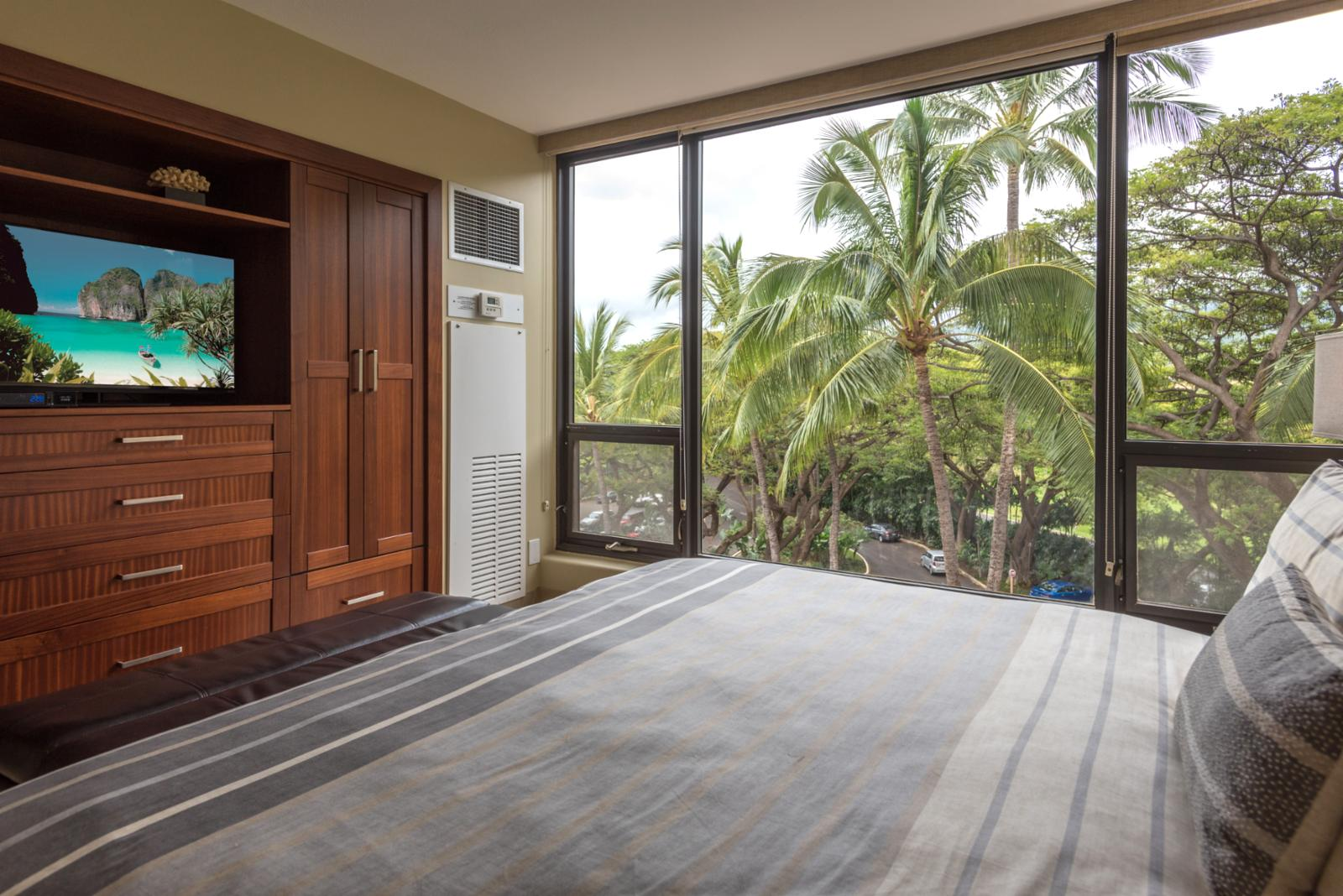 Floor to ceiling garden views from the guest bedroom