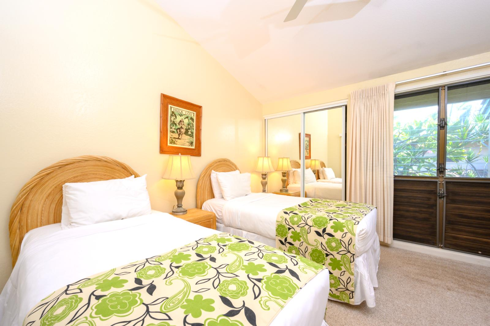 Resort views, comfortable twin bed configuration. Perfect for families!