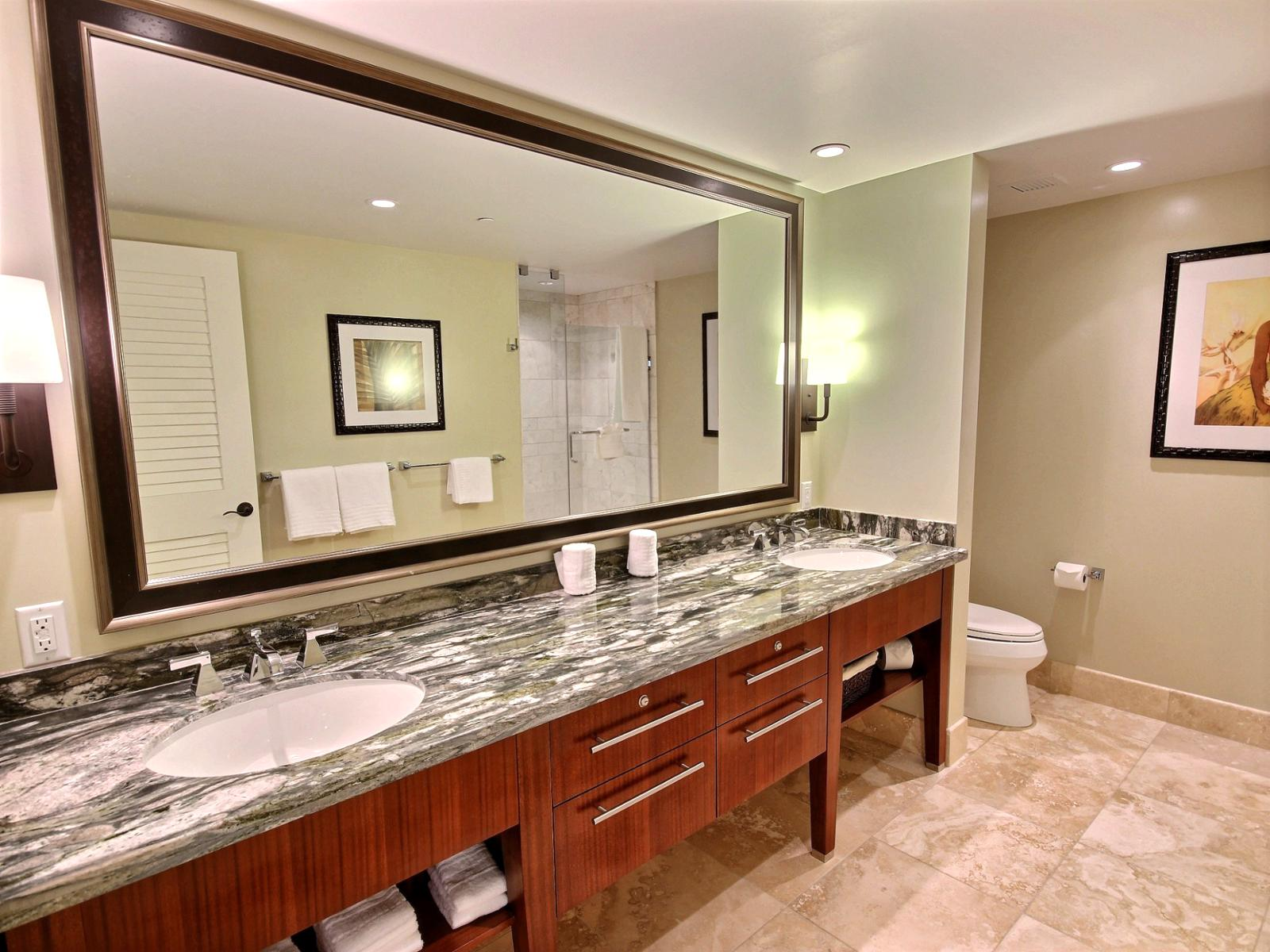 Spacious marble dual sink bathrooms