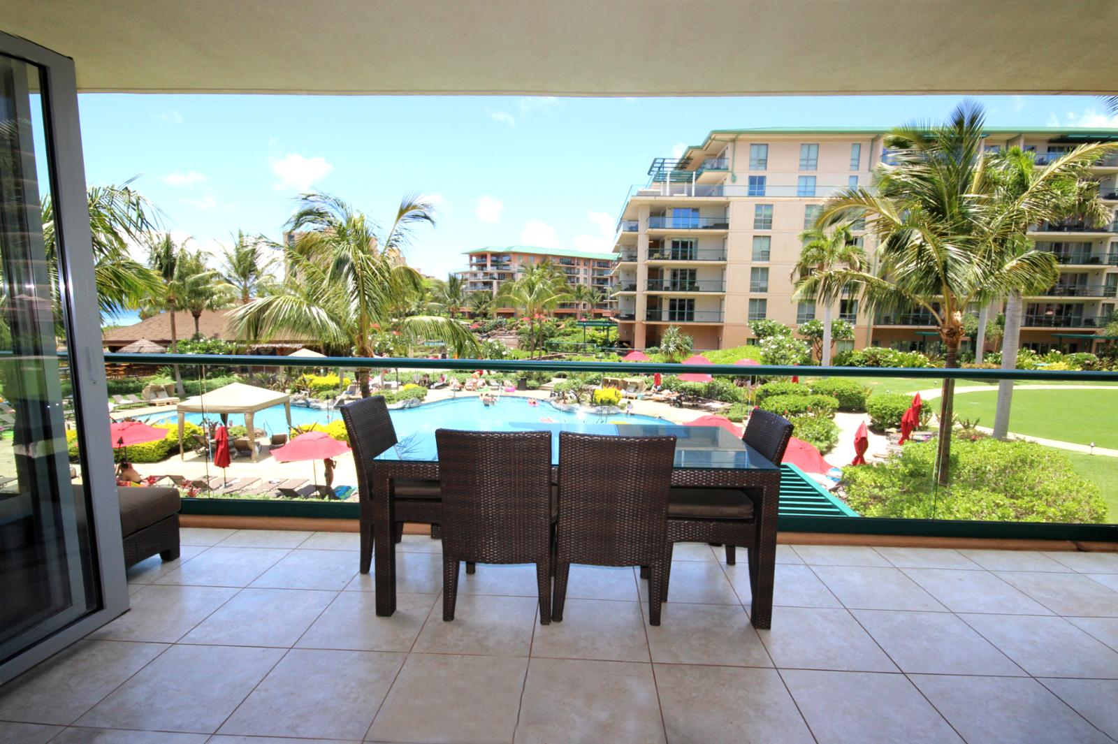 Enjoy alfresco dining on the lanai overlooking the pool and ocean