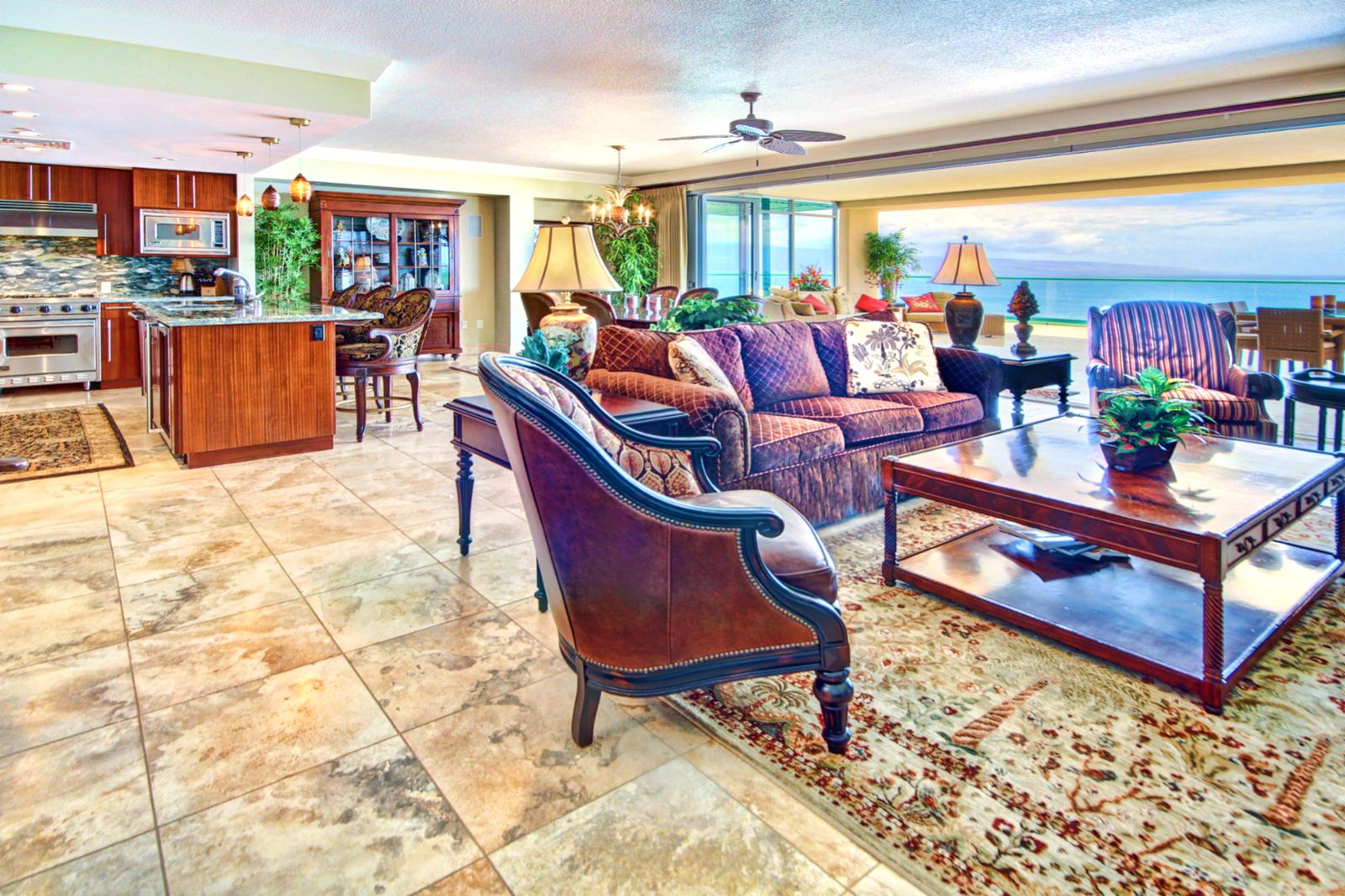 Looking across the living room you can see the great view you have from every angle in this luxury unit at Honua Kai Resort.