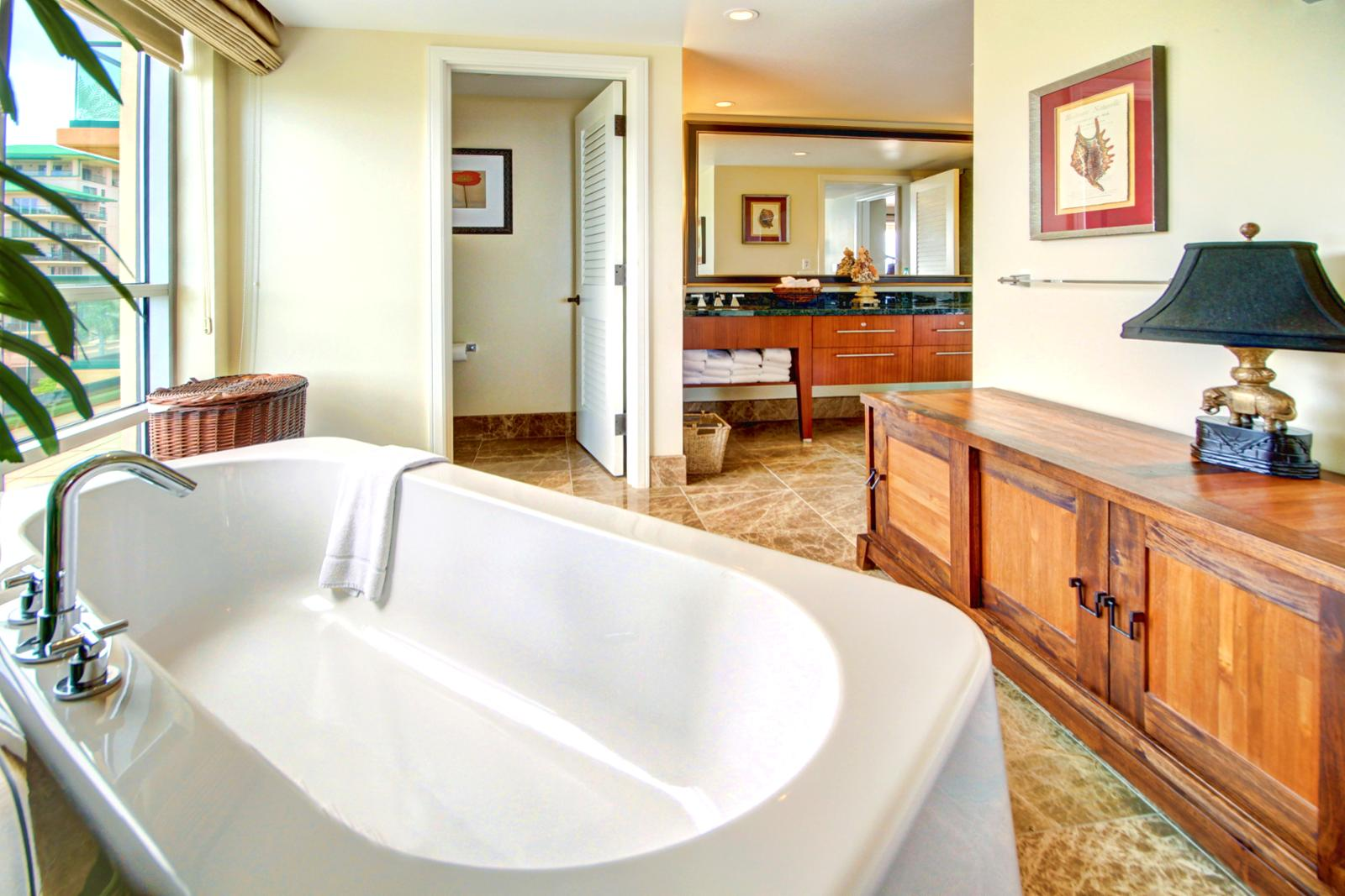 Large guest bathroom with soaking tub to relax in.