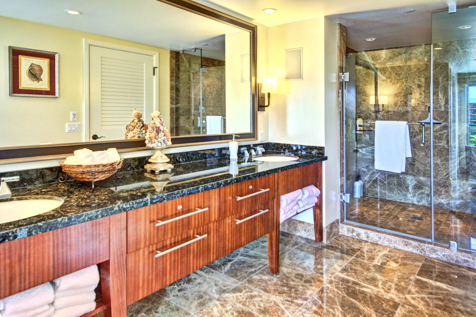 Second master bathroom has a large vanity custom mirror with dual sinks and large walk in shower.