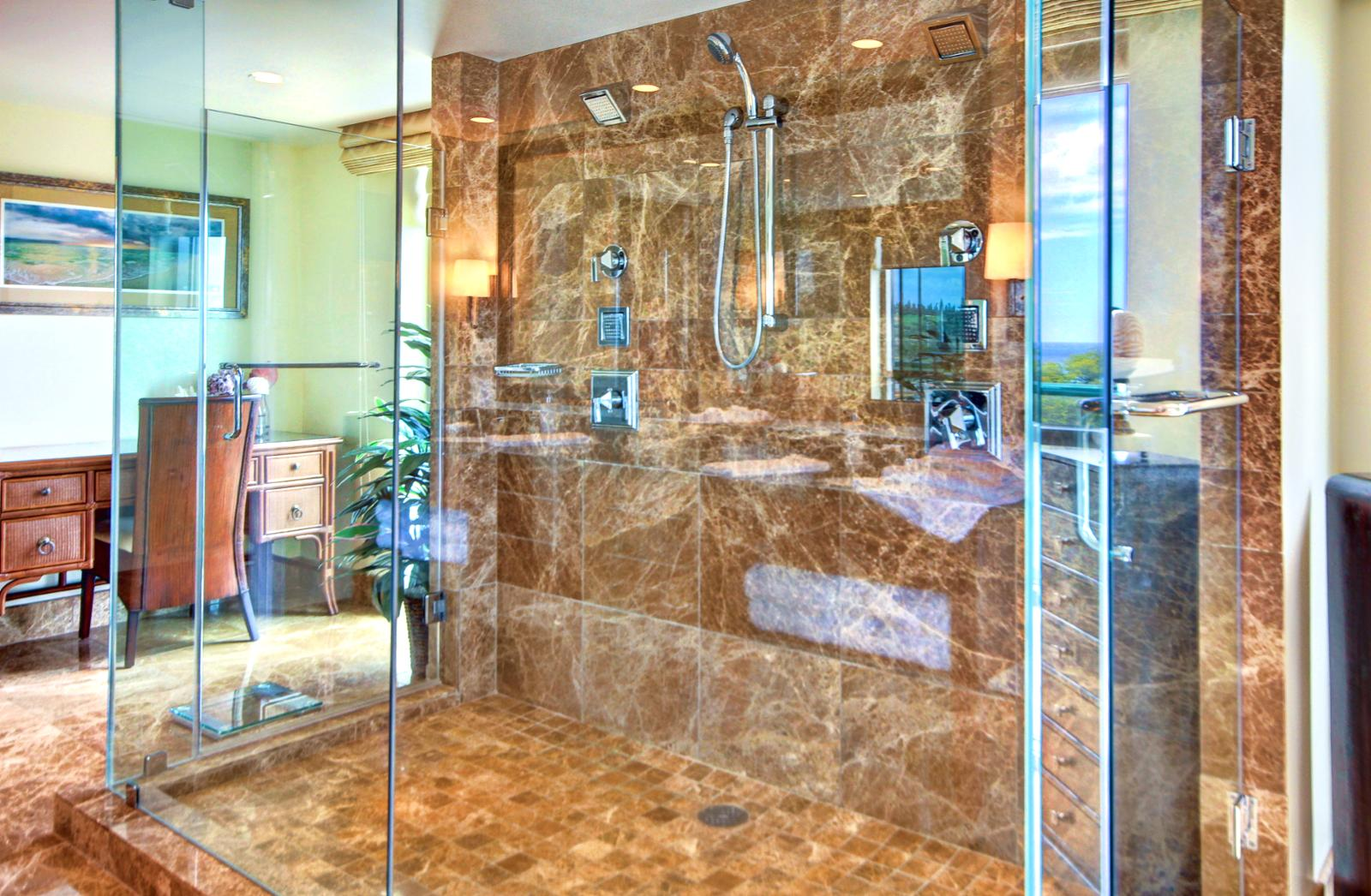 Huge master bathroom with a massive walk in shower with dual shower heads.