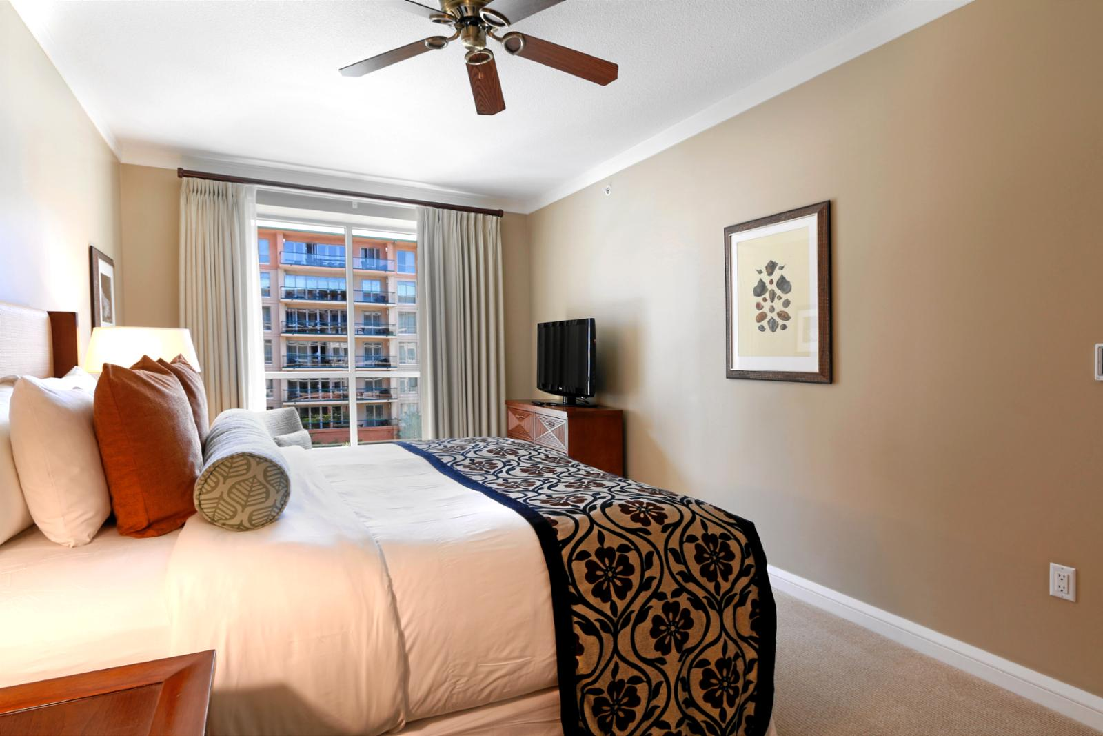 Guest bedroom has a vented window and large LG flatscreen TV for your enjoyment.