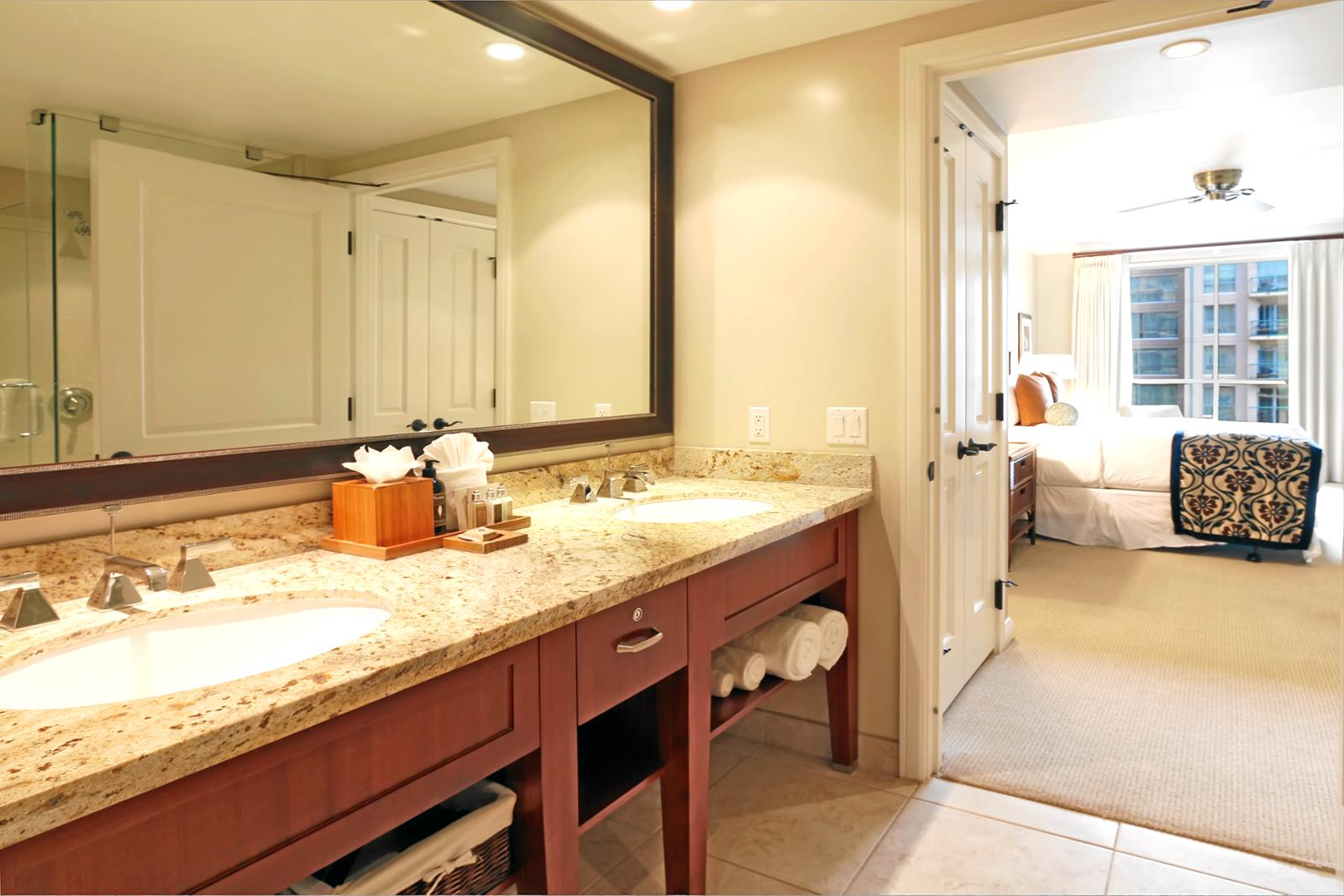 Large guest bathroom with large vanity mirror and dual sinks.