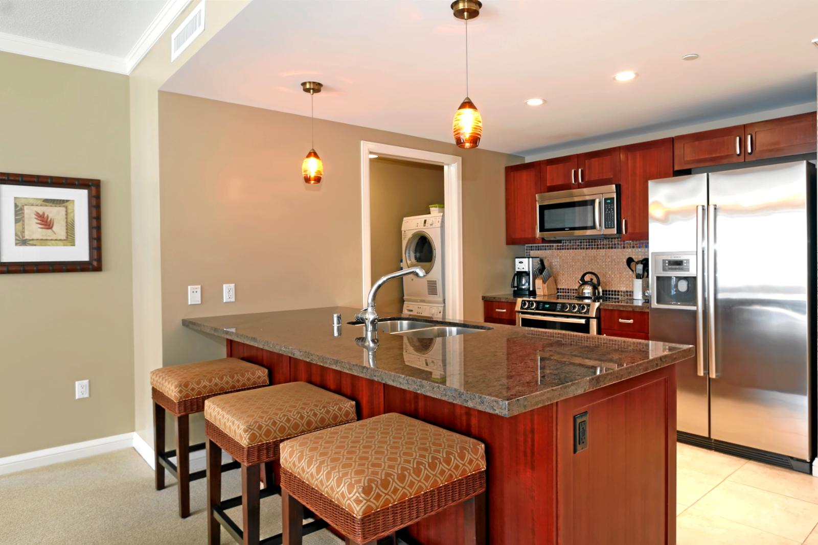 Large gourmet kitchen with full size Bosch appliances and small laundry room to the side.