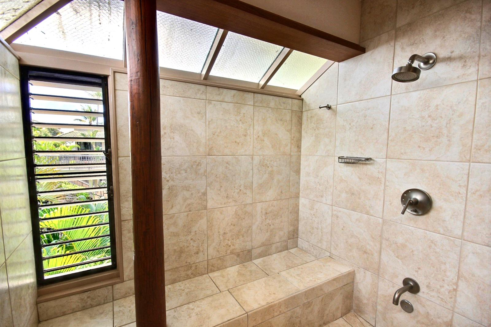 tastefully updated shower with custom tile throughout.