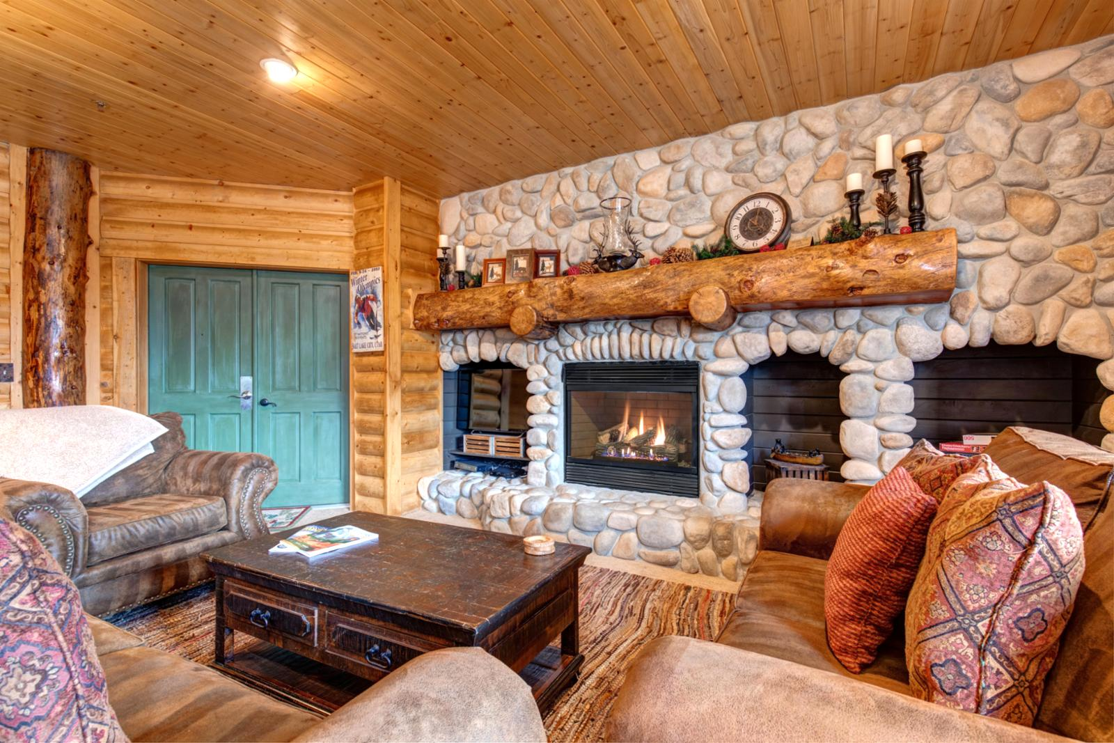 Cozy living room with river rock gas fireplace