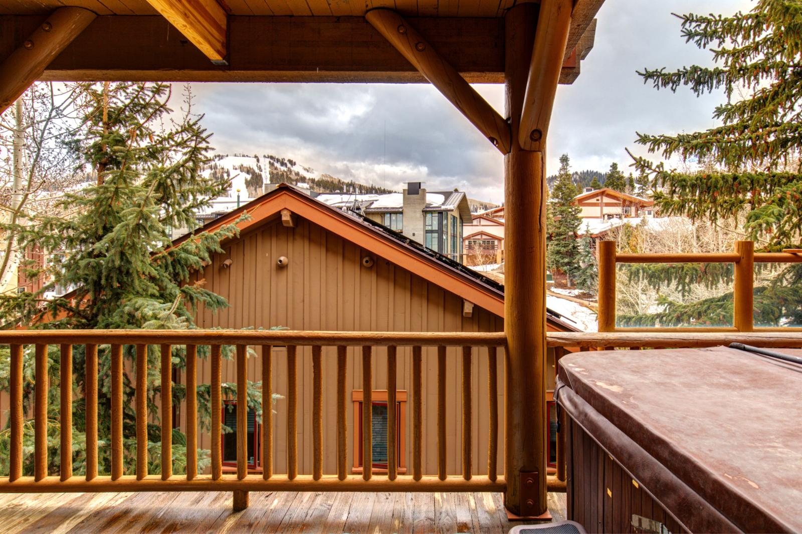 Soak in this large hot tub surrounded by mountain views