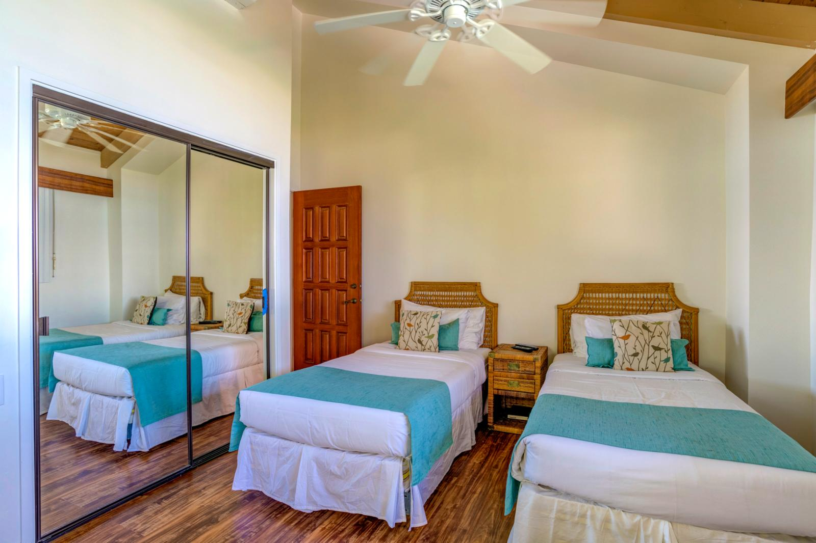 Comfortable twin bed configuration and equipped with ceiling fans.