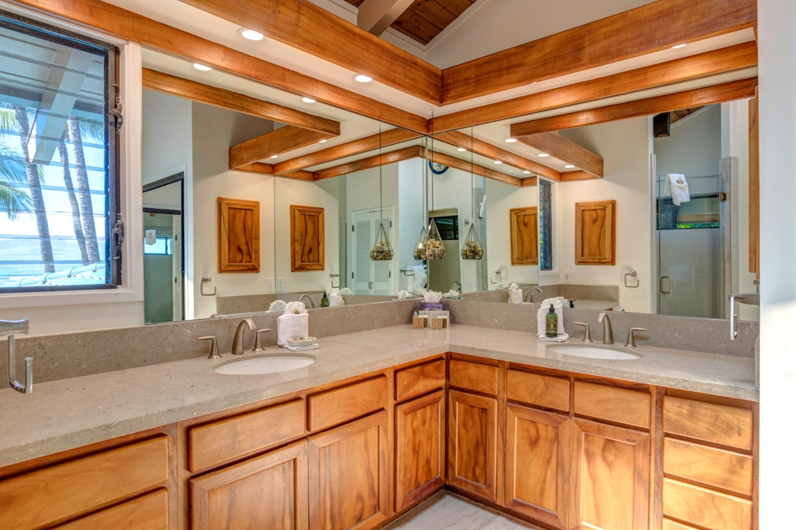 Custom dual sinks and ocean views from your master bath suite