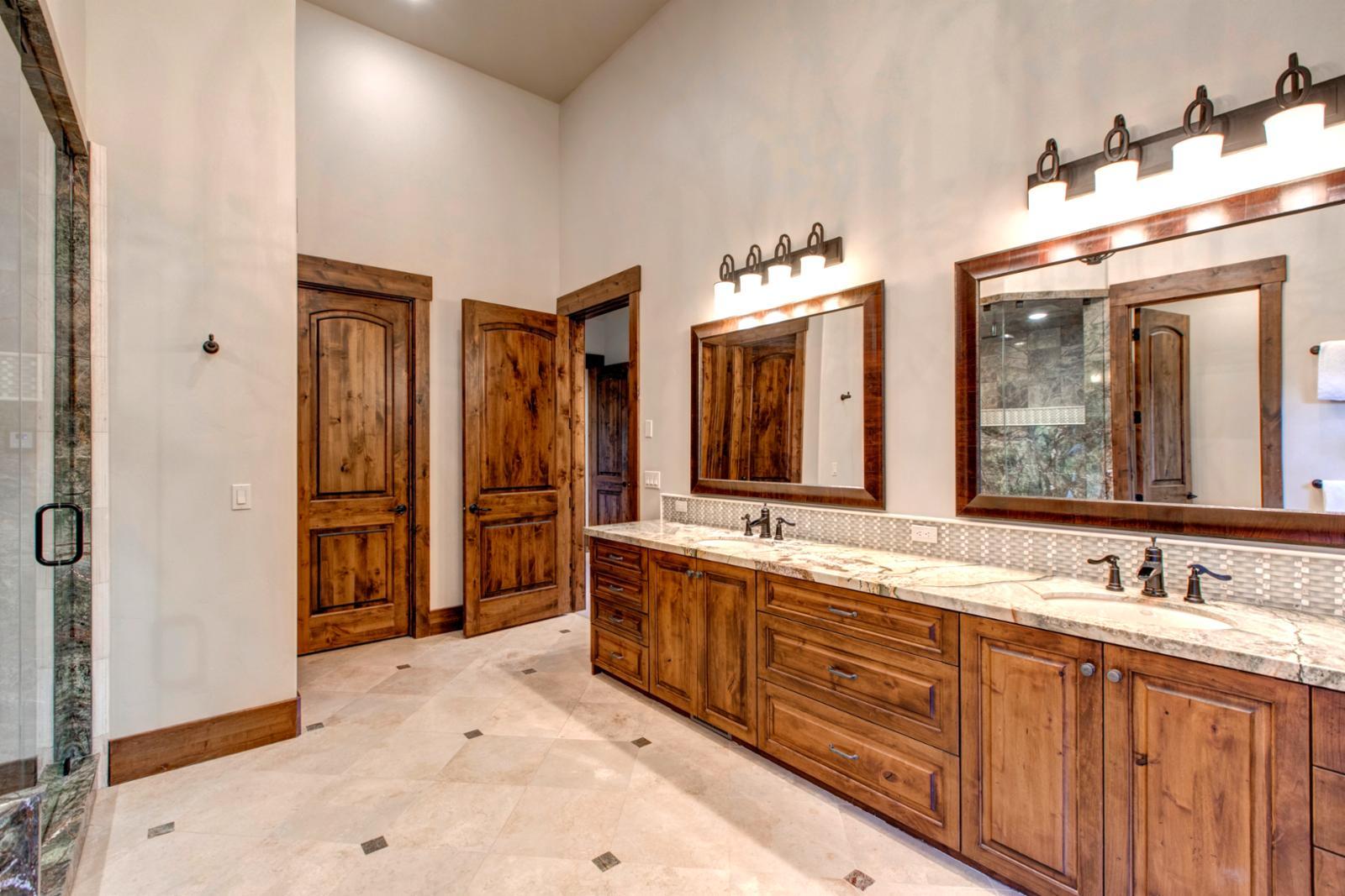 Enjoy the master bathroom encased with unique granite