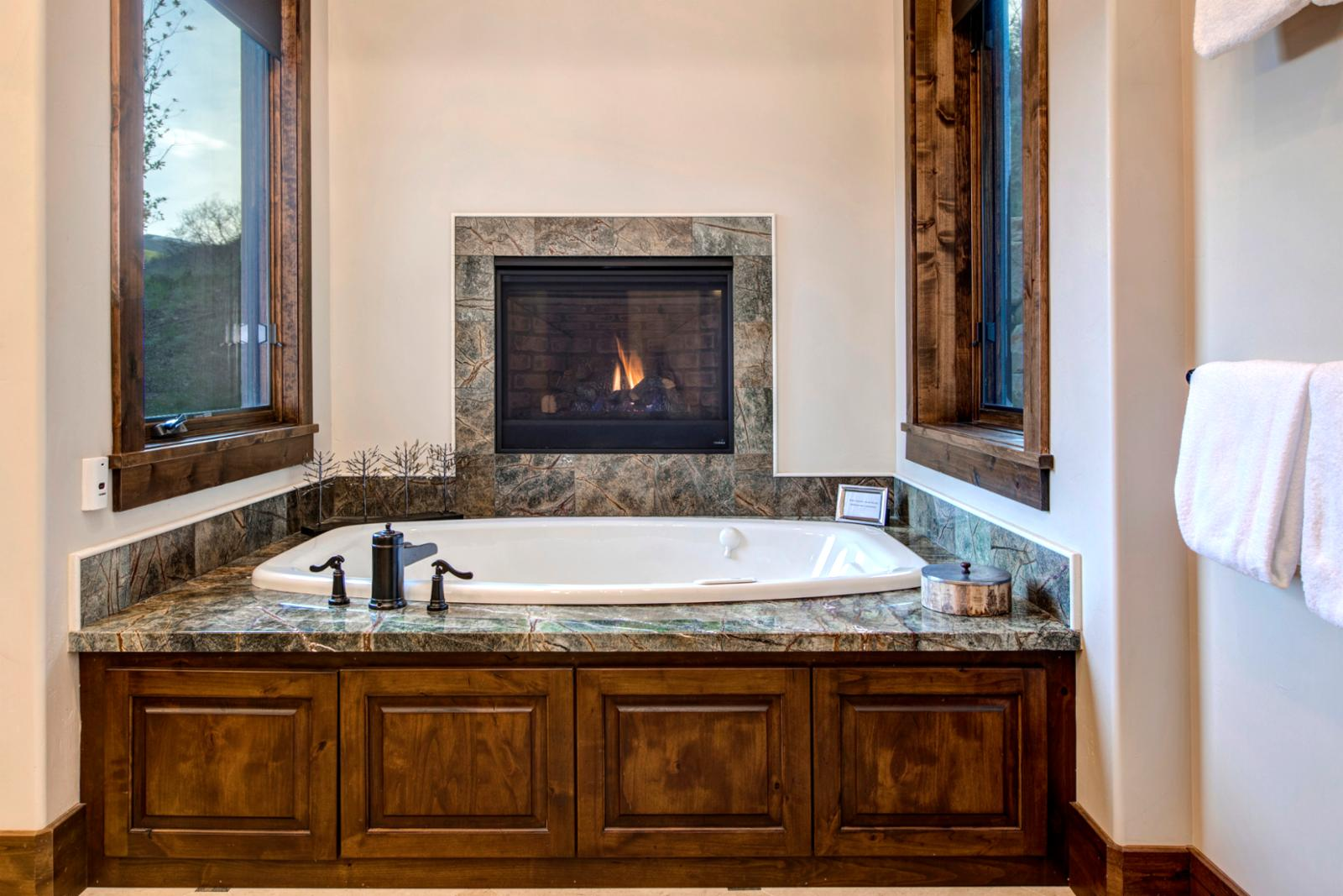Master bathroom with fireplace and soaking tub, what more can you ask for?