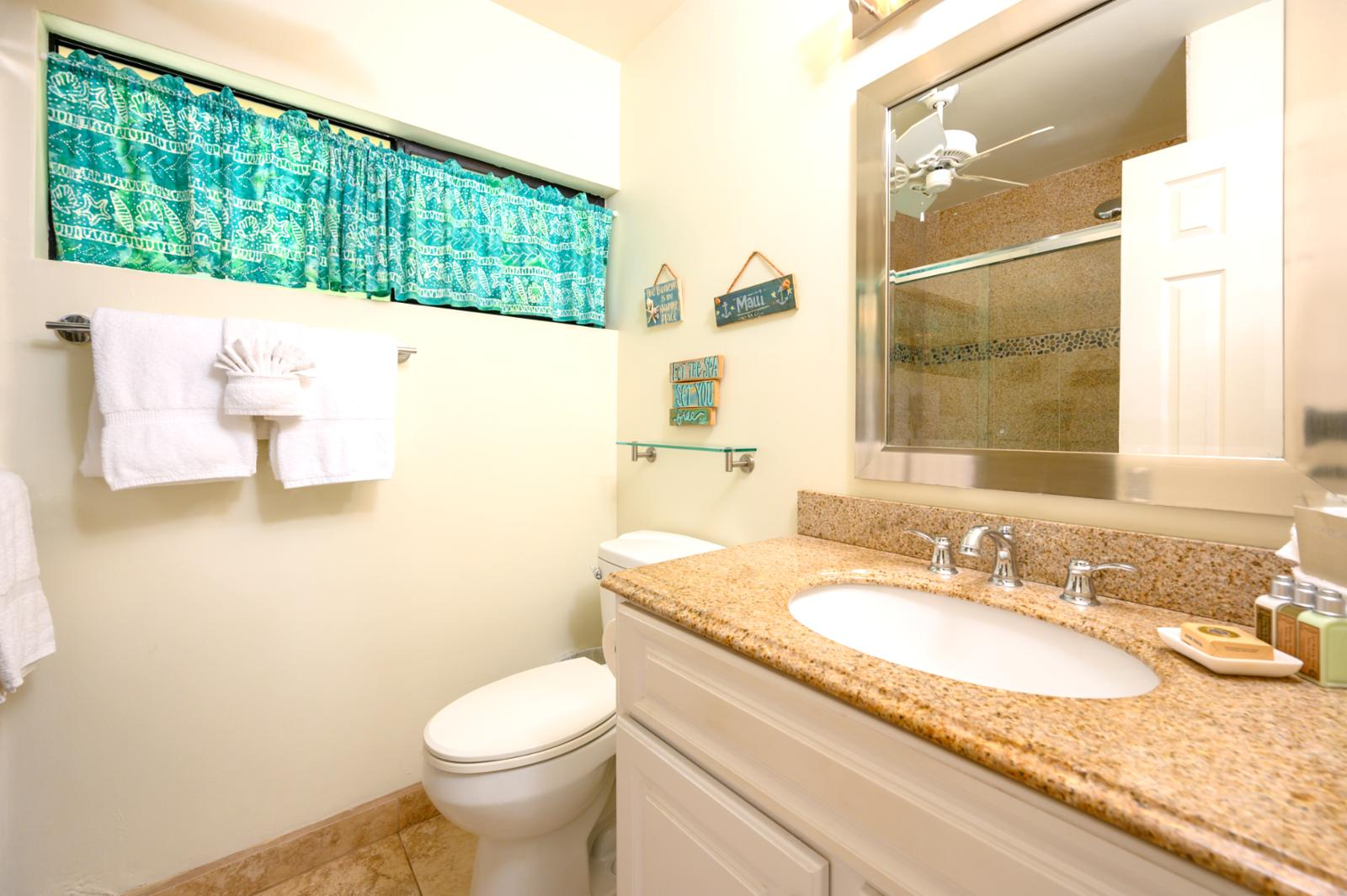 Guest bathroom is located on the 1st floor with hallway access