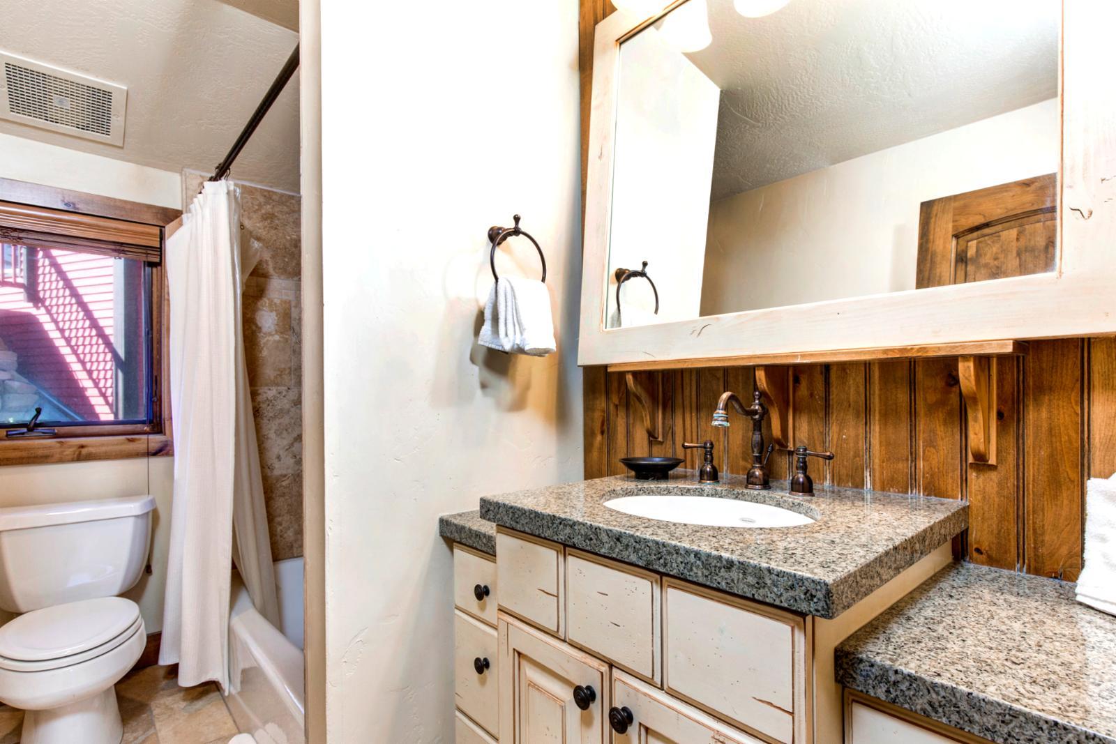 Shared bathroom with plenty of room
