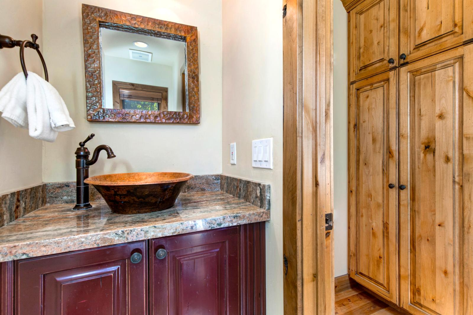 Discreet powder room off of the kitchen