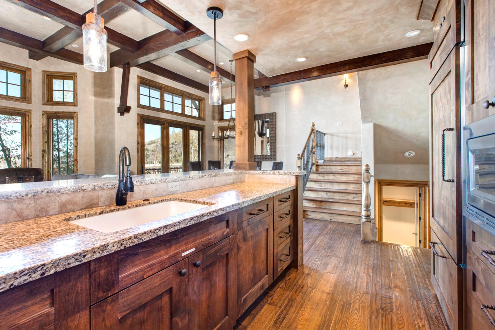 This beautiful kitchen has granite counters and Wolf appliances