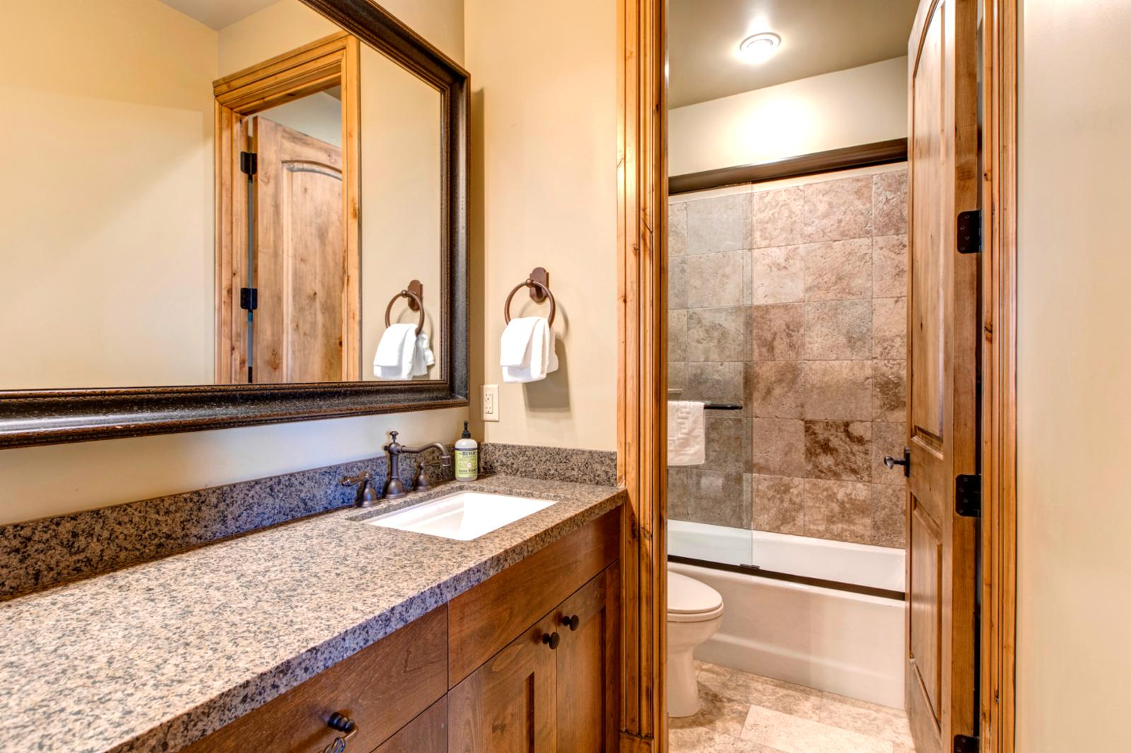 Bathroom in lower level is shared by the King lower bedroom and family movie room