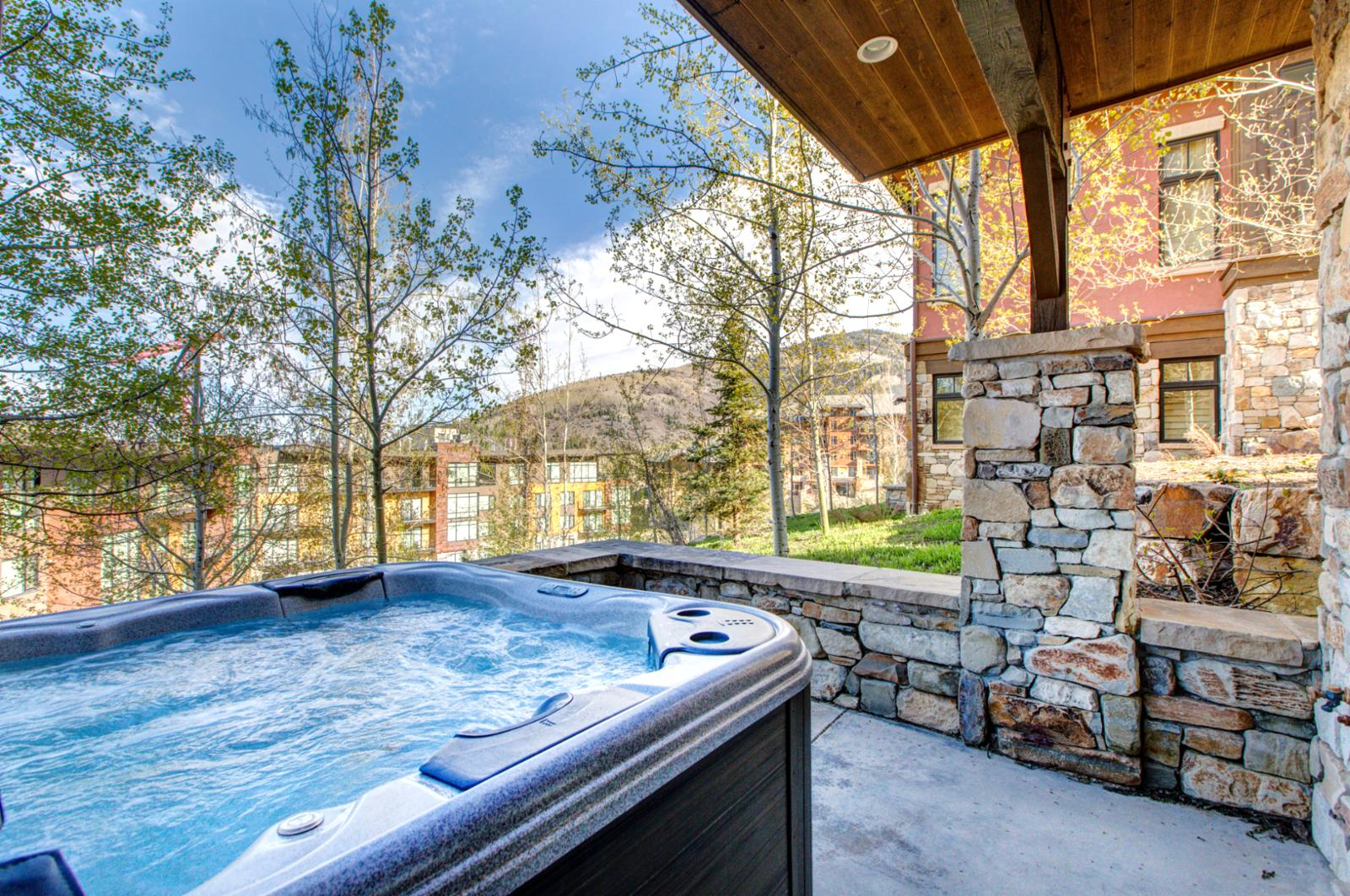 Private hot tub is located right off the lower level family room